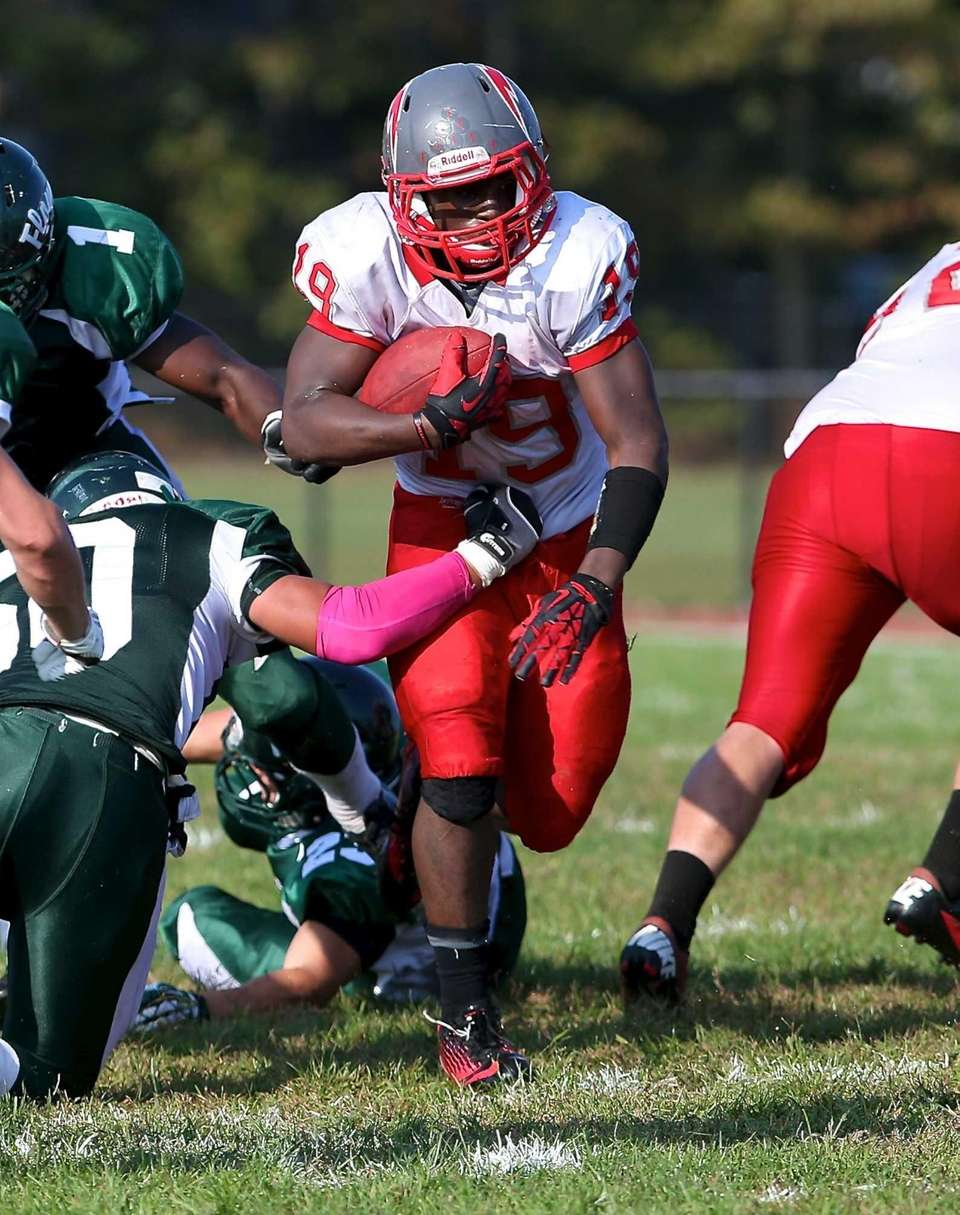Connetquot running back Marcus Gutierrez rushes against the