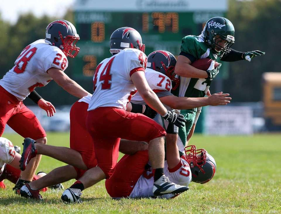 William Floyd's John Rivera (no. 23) is tackled