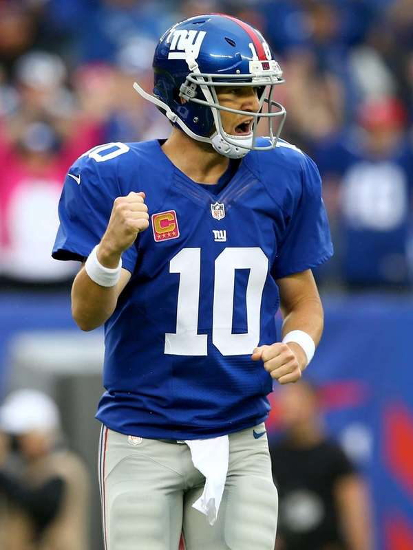 Eli Manning celebrates a touchdown in the first