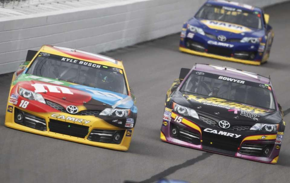 Drivers Kyle Busch (18) and Clint Bowyer (15)