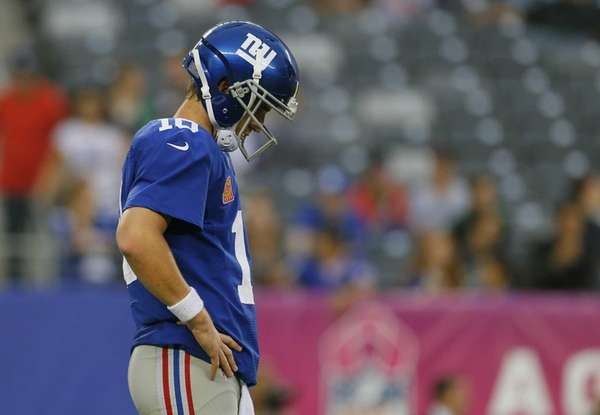 Eli Manning looks on in the fourth quarter