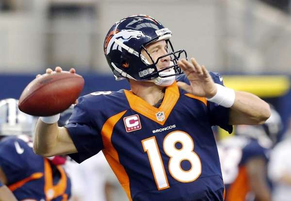 Denver Broncos quarterback Peyton Manning passes the ball