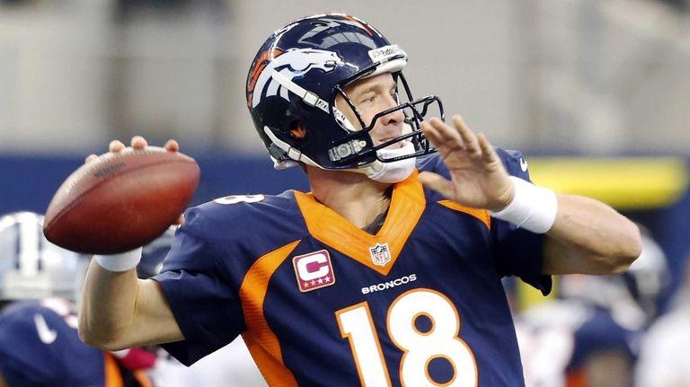Denver Broncos quarterback Peyton Manning passes the ball