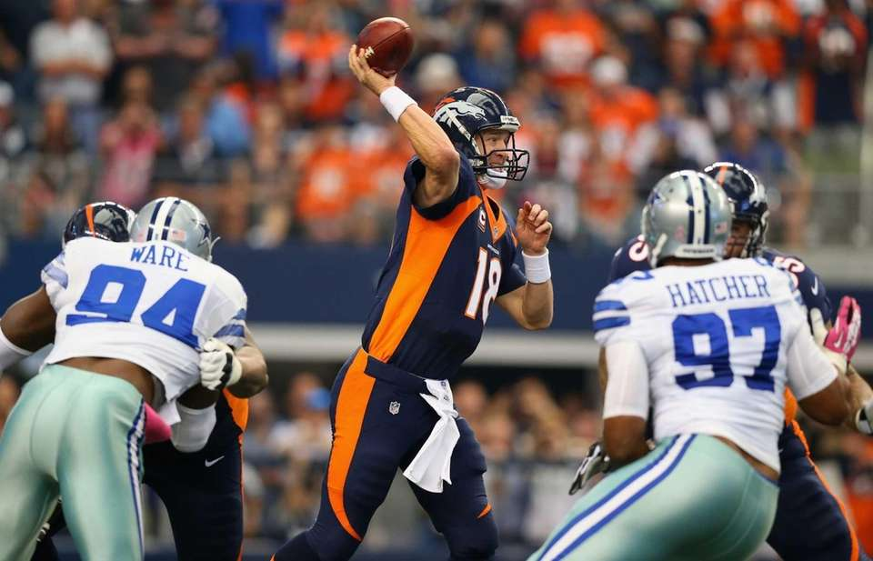 Denver Broncos quarterback Peyton Manning throws against the