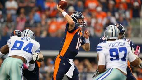 Denver Broncos quarterback Peyton Manning throws against the