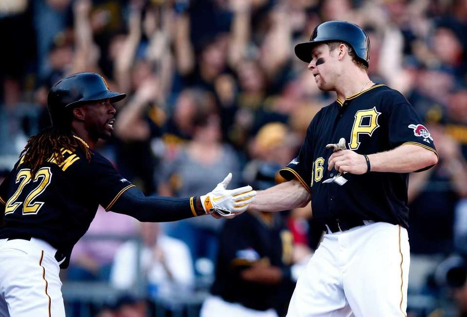 Justin Morneau #66 and Andrew McCutchen #22 of