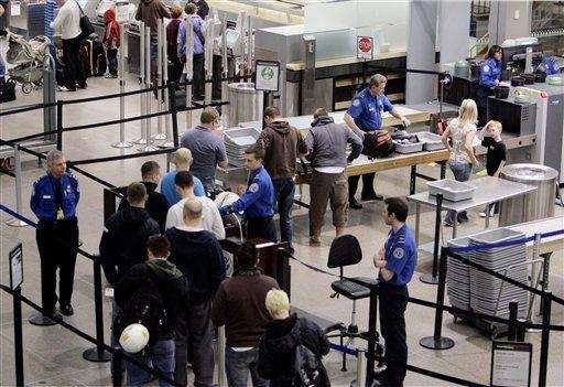 Airline passengers line up at the TSA security