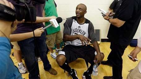 Jason Terry speaks with members of the media