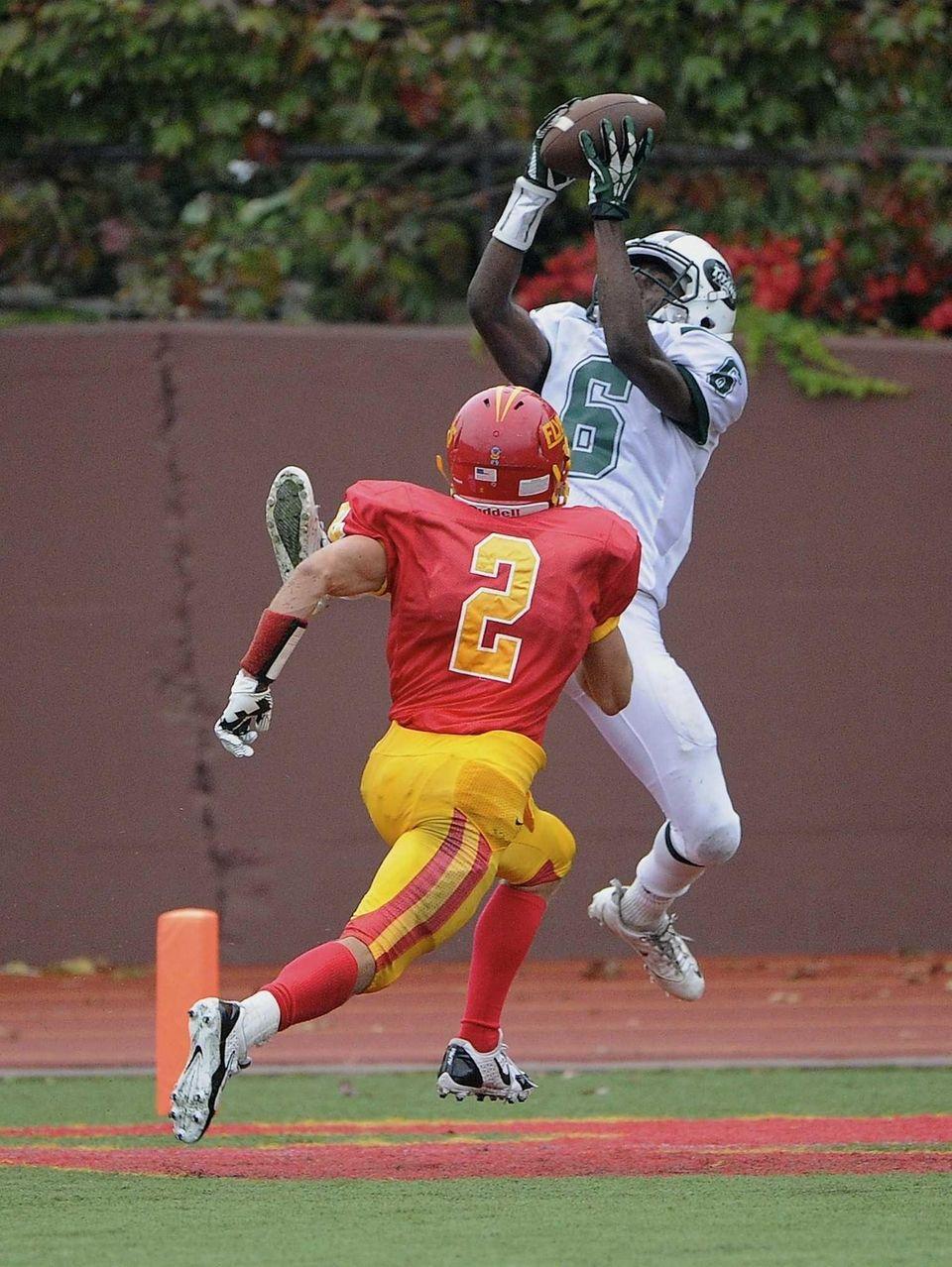 Holy Trinity's Earl Myers catches the football i