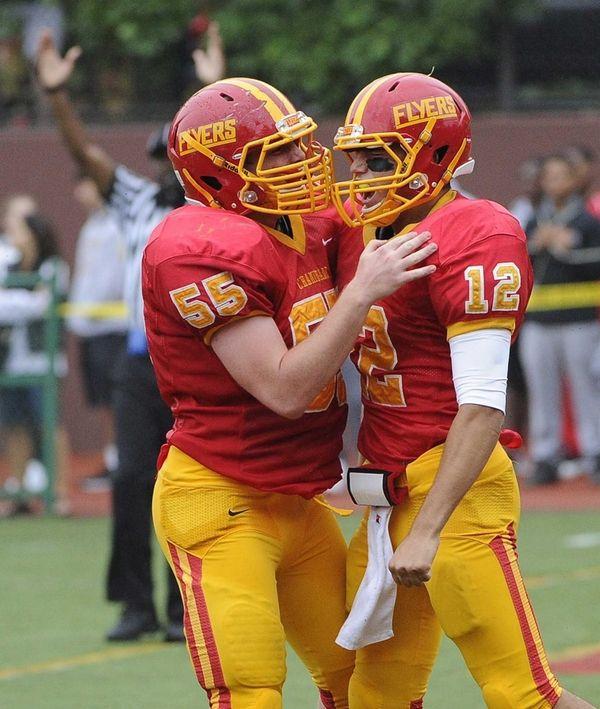 Chaminade offensive lineman Gerard Arnold congratulates quarterback Sean