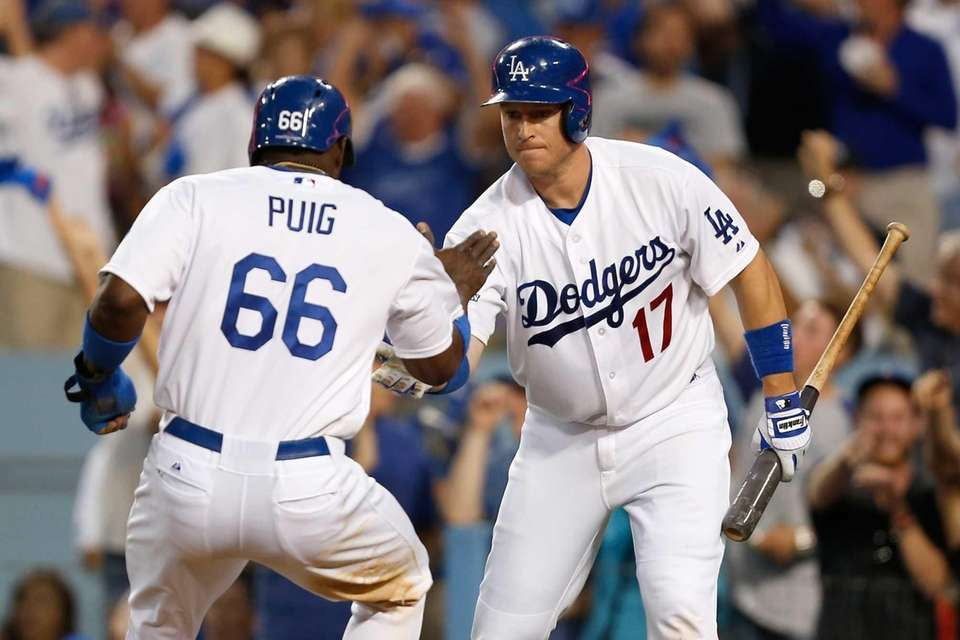 The Los Angeles Dodgers' Yasiel Puig celebrates with