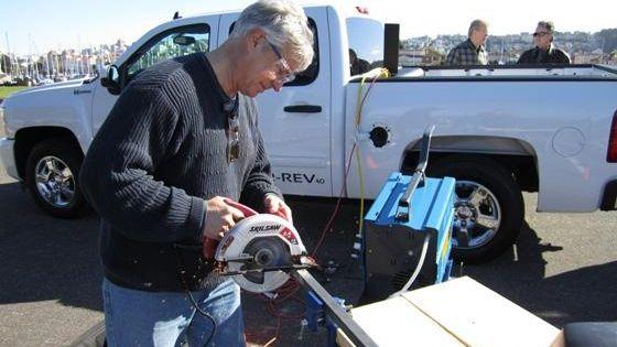 A Via Motors craftsman working on a car