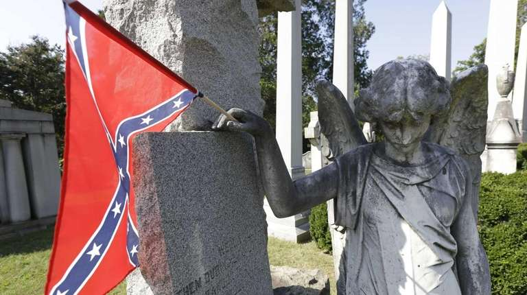 A Confederate battle flag adorning a statue in