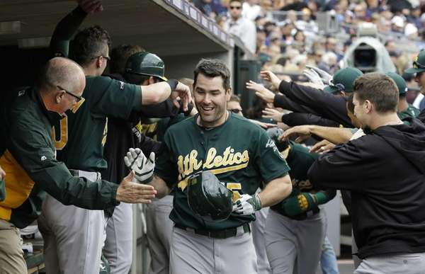 Oakland Athletics designated hitter Seth Smith (15) is
