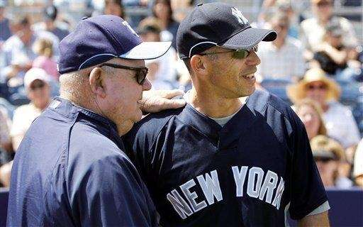 Yankees manager Joe Girardi, right, talks with Tampa