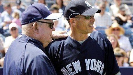 Yankees manager Joe Girardi, right, talks with Tampa