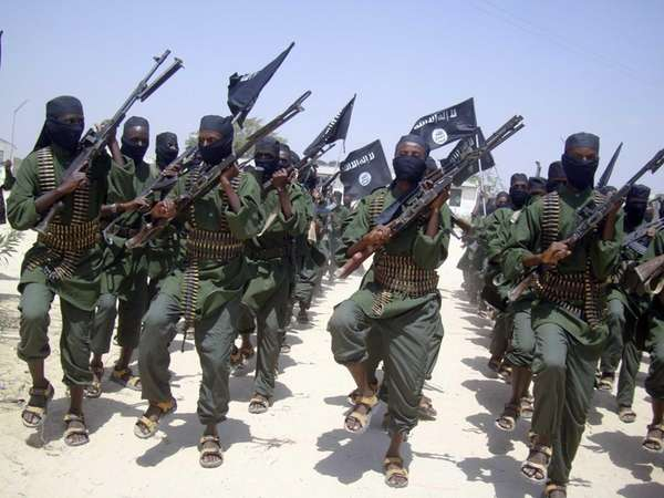 al-Shabab fighters march with their weapons during military