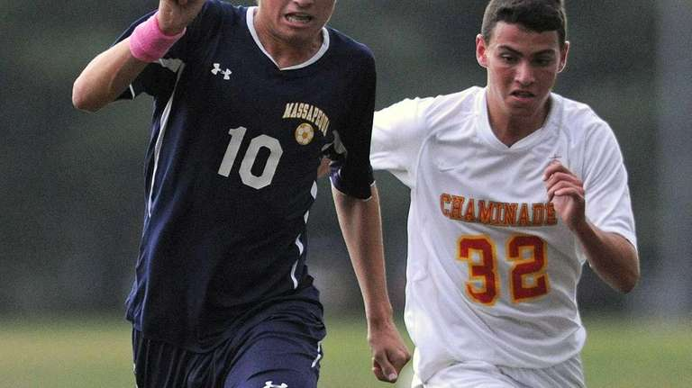 Massapequa's Brian Nichtern, left, looks to stay ahead