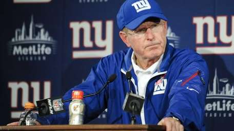 Tom Coughlin responds to questions during a news