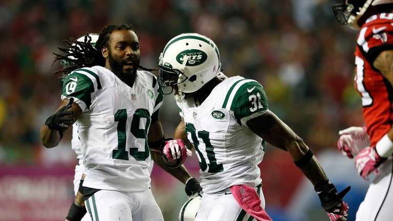 The Jets' Clyde Gates and Antonio Cromartie celebrate
