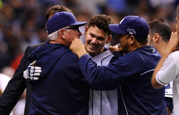Tampa Bay Rays' Jose Lobaton is hugged by
