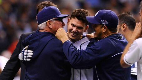 Tampa Bay Rays' Jose Lobaton is hugged by
