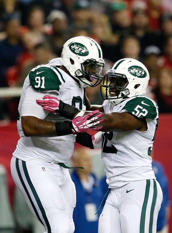 Sheldon Richardson celebrates a sack with David Harris
