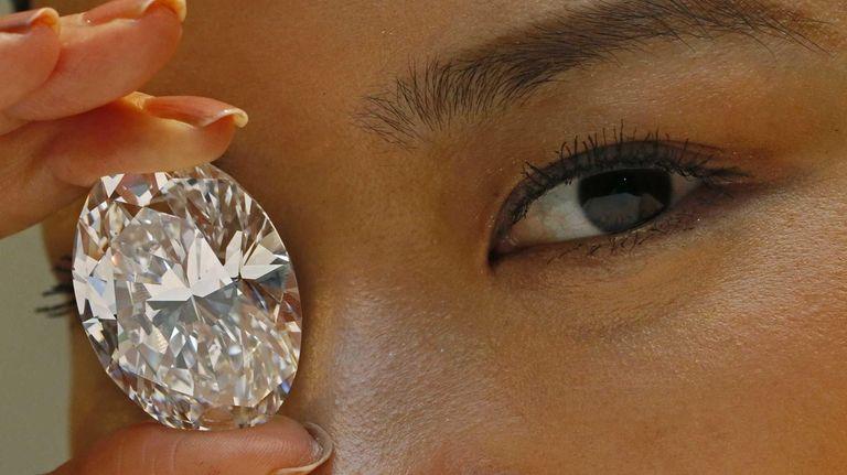 This 118.28-carat white diamond sold for $27.3 million