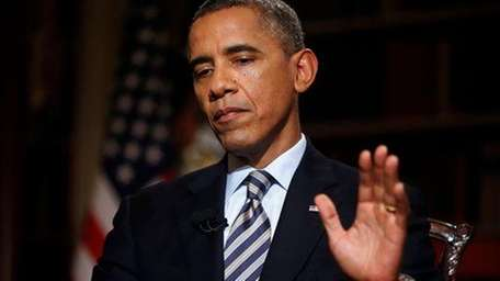President Barack Obama speaks during an interview in