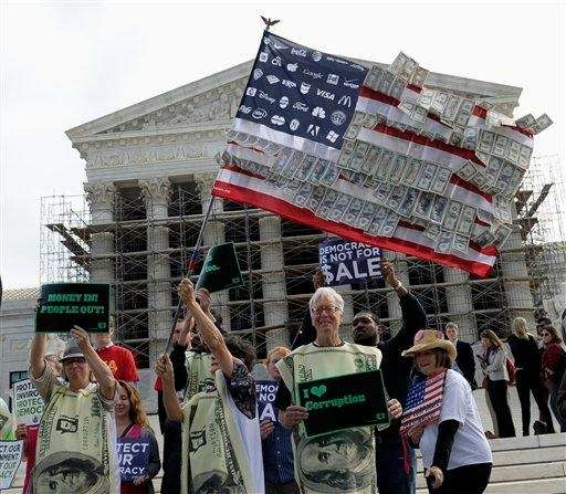 Demonstrators gather outside the Supreme Court in Washington,