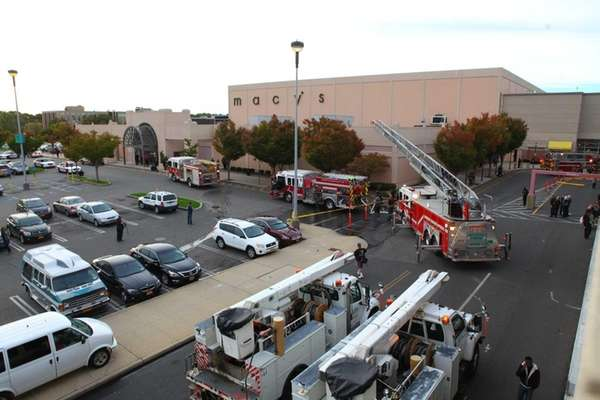 Firefighters respond to an fire at Macy's at