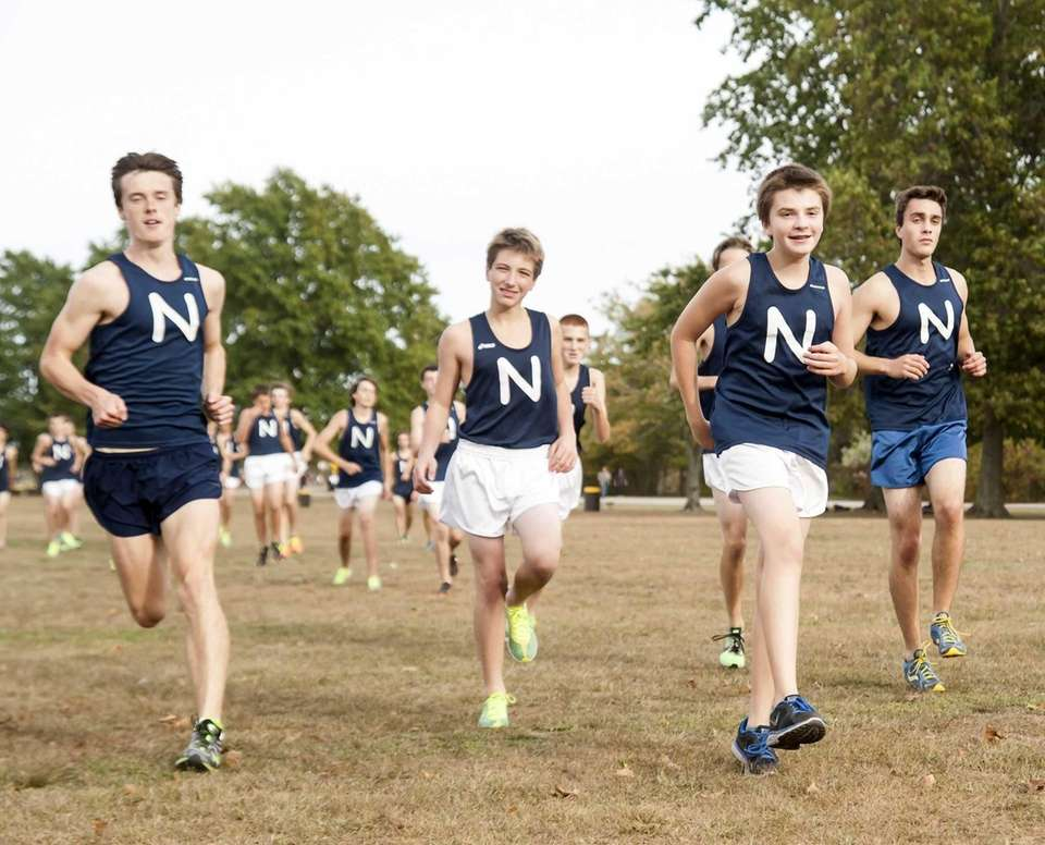 Members of Northport's boys cross country team warm