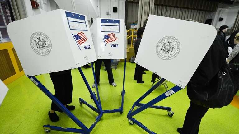 Residents cast their ballots to vote in the