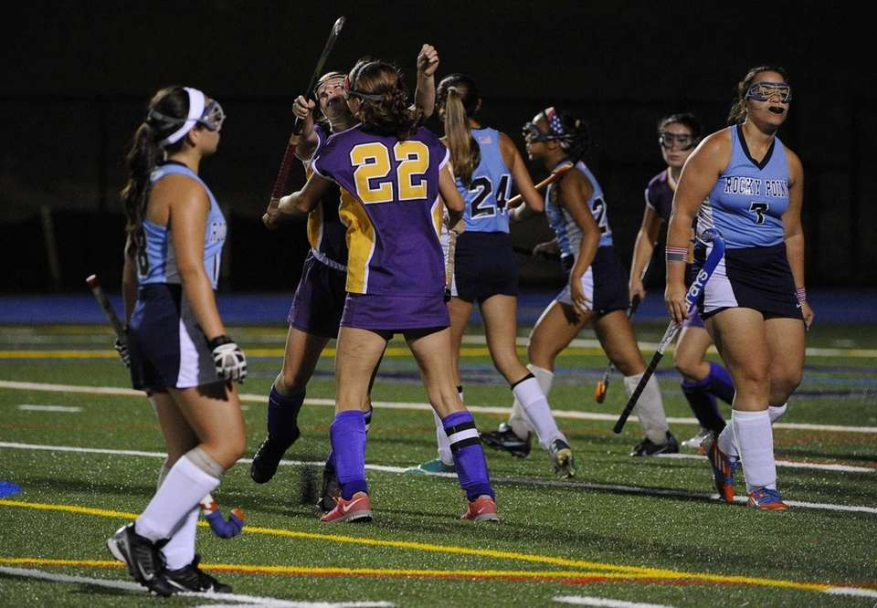 Sayville's Justine O'Reilly is congratulated by Olivia Russell