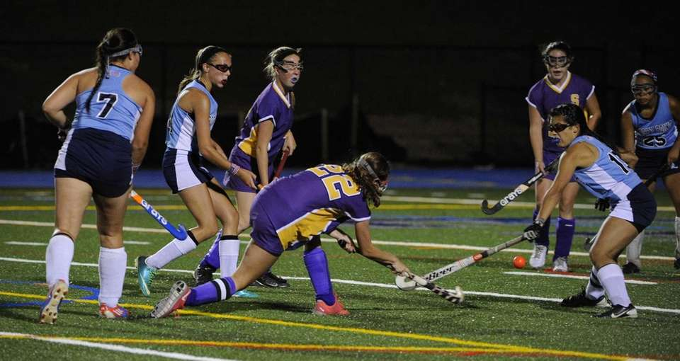 Sayville's Justine O'Reilly shoots and scores against Rocky