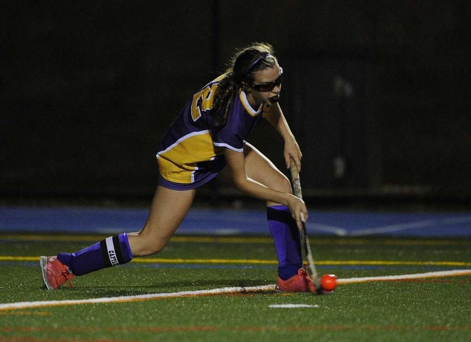 Sayville's Justine O'Reilly passes the ball against Rocky