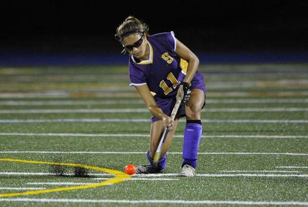 Sayville's Zoe Norton strikes the ball against Rocky