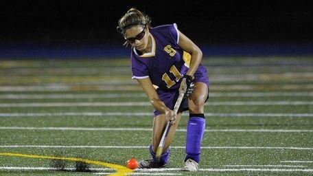 Sayville's Zoe Norton strikes the ball against Rocky