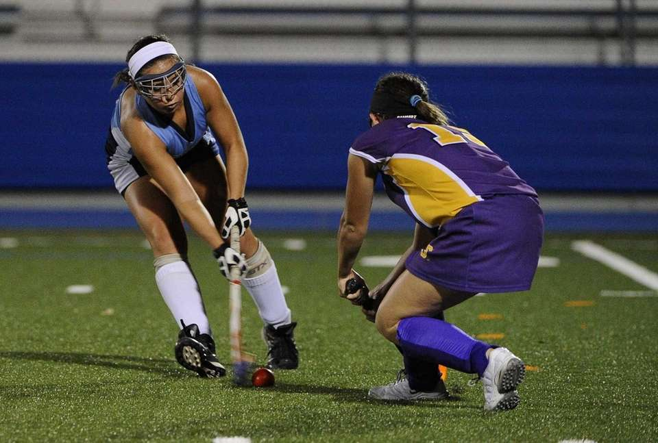 Rocky Point's Taylor Brodsky is defended by Sayville's