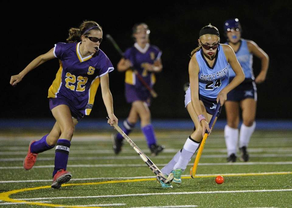Sayville's Justine O'Reilly defends against Rocky Point's Kayly