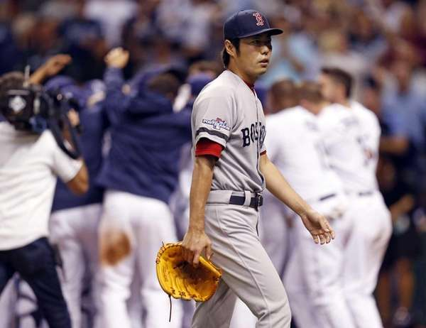 Boston Red Sox's relief pitcher Koji Uehara walks