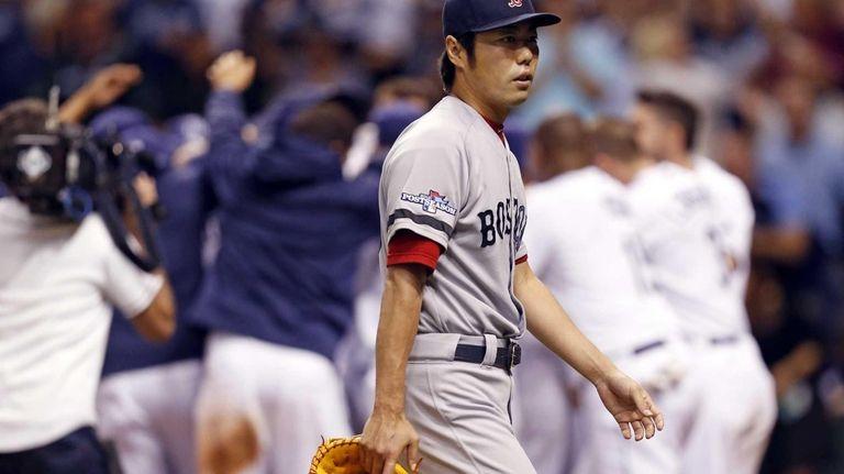 Boston Red Sox's relief pitcher Koji Uehara walks