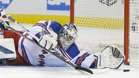 Rangers goalie Henrik Lundqvist stops a shot on