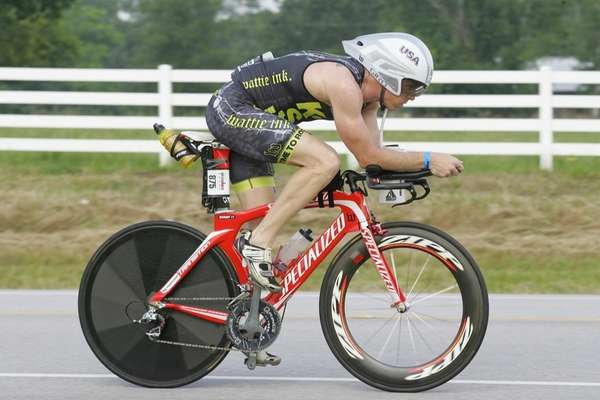 Ironman athlete Kevin Dessart competes in the cycling