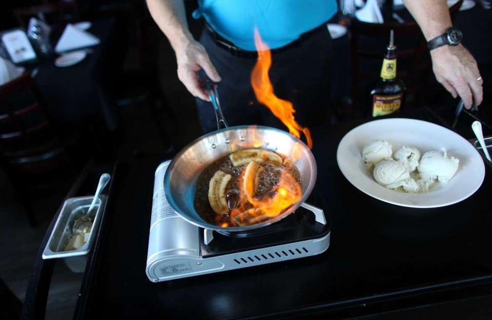 Co-owner Tom Curry prepares Bananas Foster at Storyville