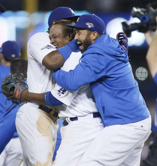 The Los Angeles Dodgers' Juan Uribe, center, is