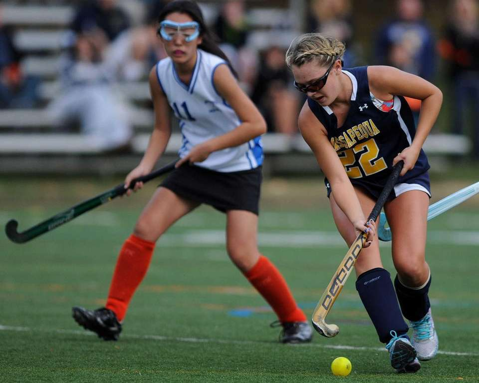 Massapequa's Gabriella Curtis moves the ball past midfield