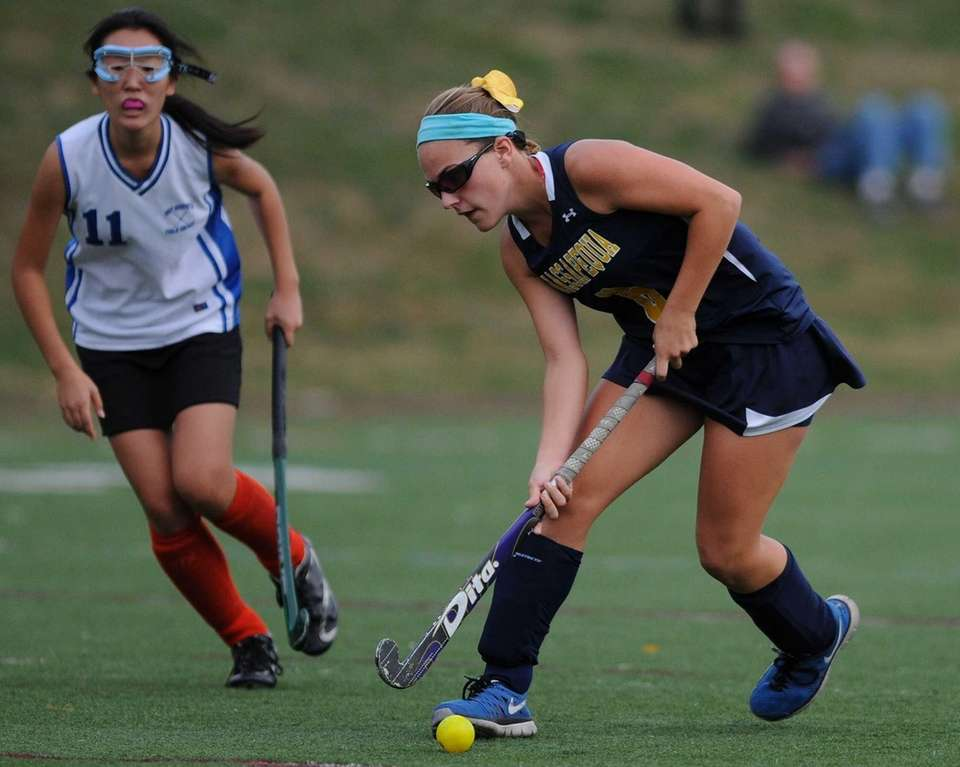 Massapequa's Jamie Ahrens looks to get a shot