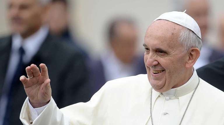 Pope Francis waves to the faithfull after leading