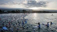 Amateur Ironman athletes wait for the start of